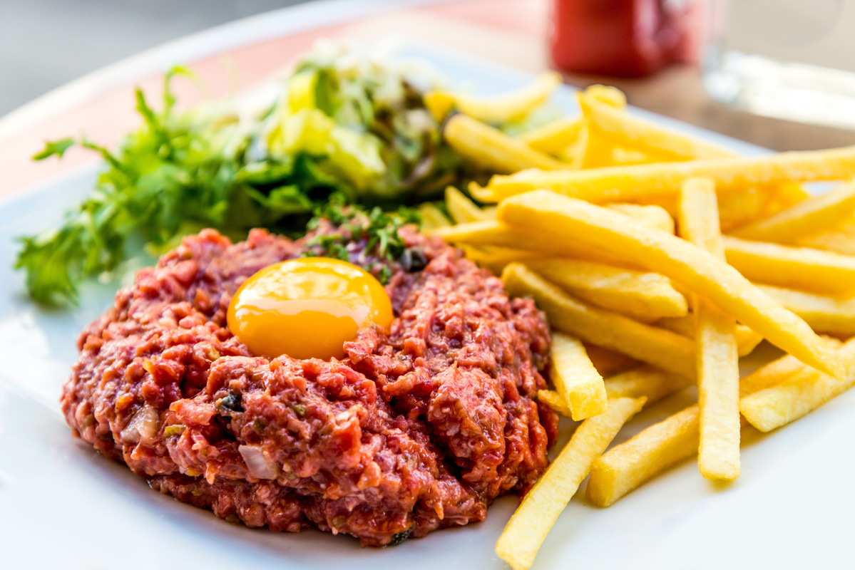 Steak Tartare (minced raw beef prepared with brandy and Tabasco then topped with an egg… much more delicious than it sounds).