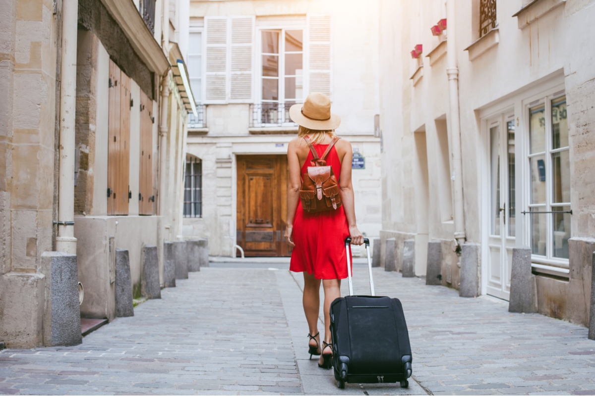 woman with suitcase Europe packing like a pro