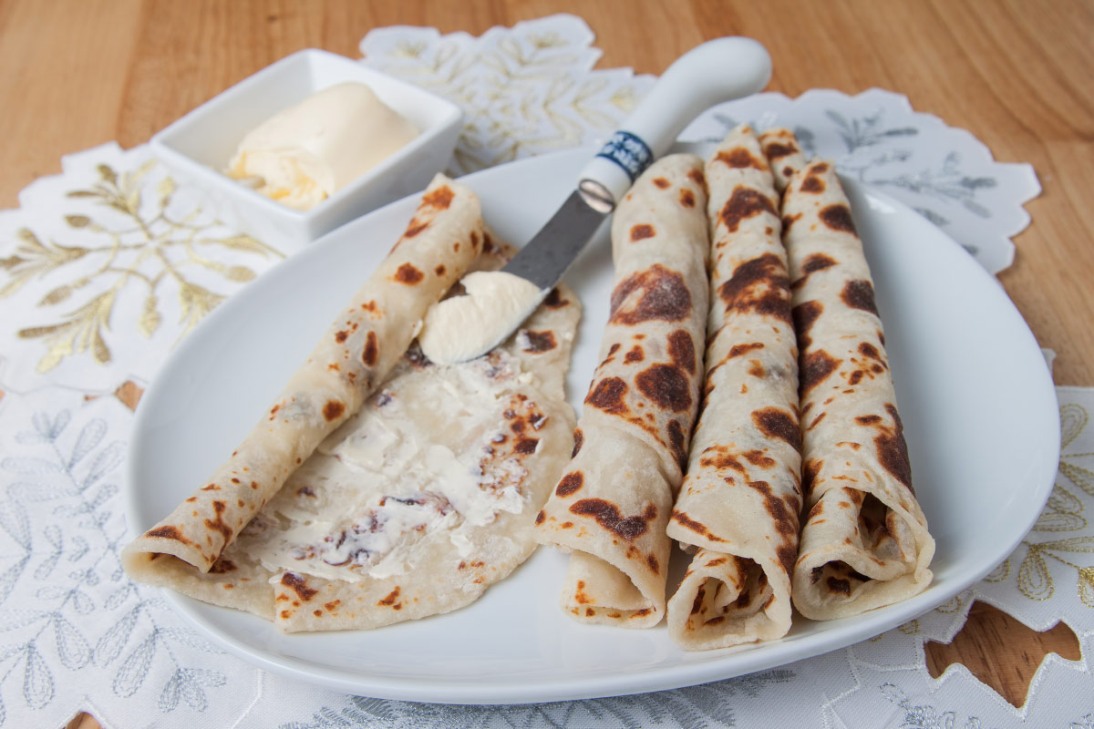 Lefse and butter on plate food bucket list