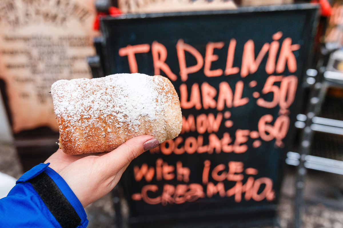 Woman holding trdelnik food bucket list