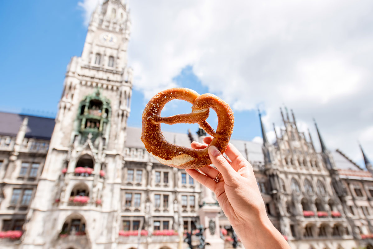 Woman holding pretzel in Germany food bucket list