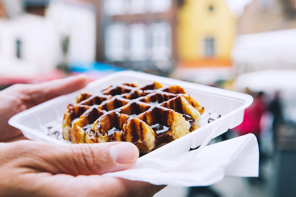 Man holding chocolate Belgian waffles food bucket list
