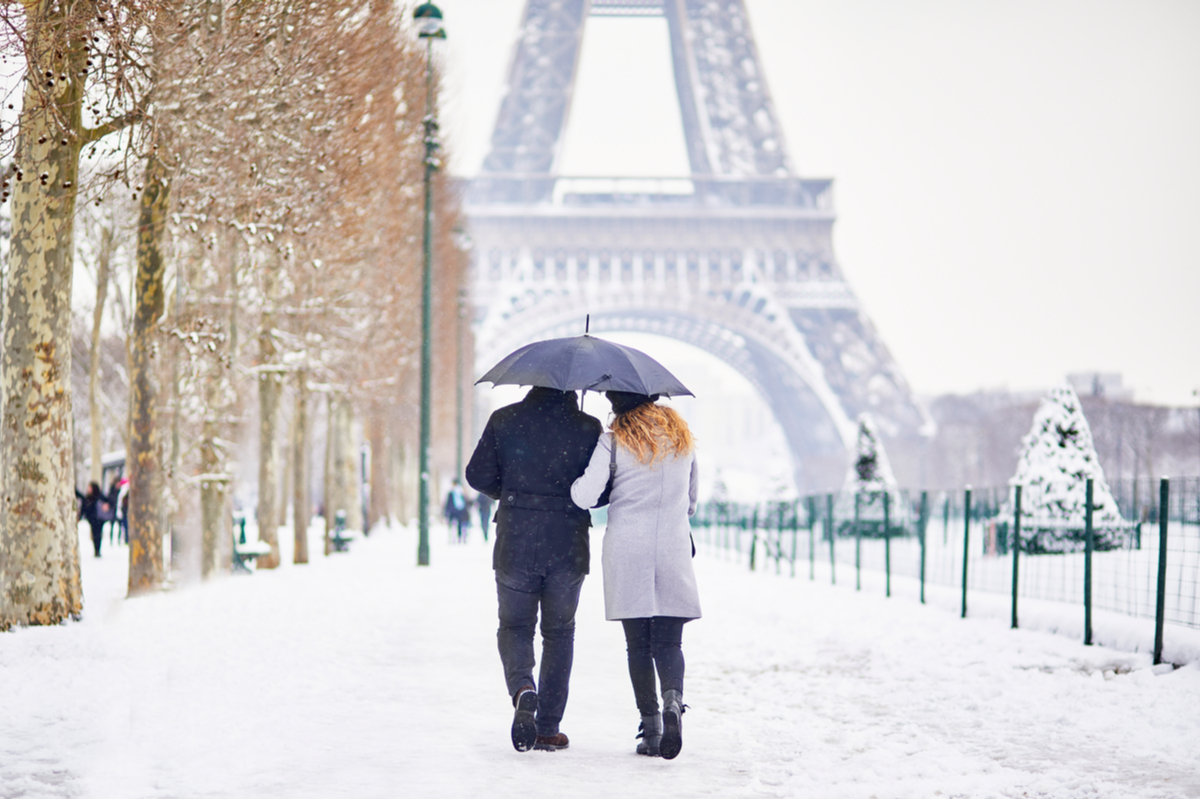Couple walking near Eiffel Tower Paris winter holiday Europe