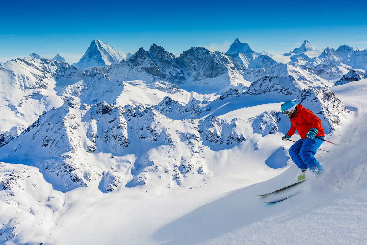 Man skiing Swiss Alps winter holiday Europe