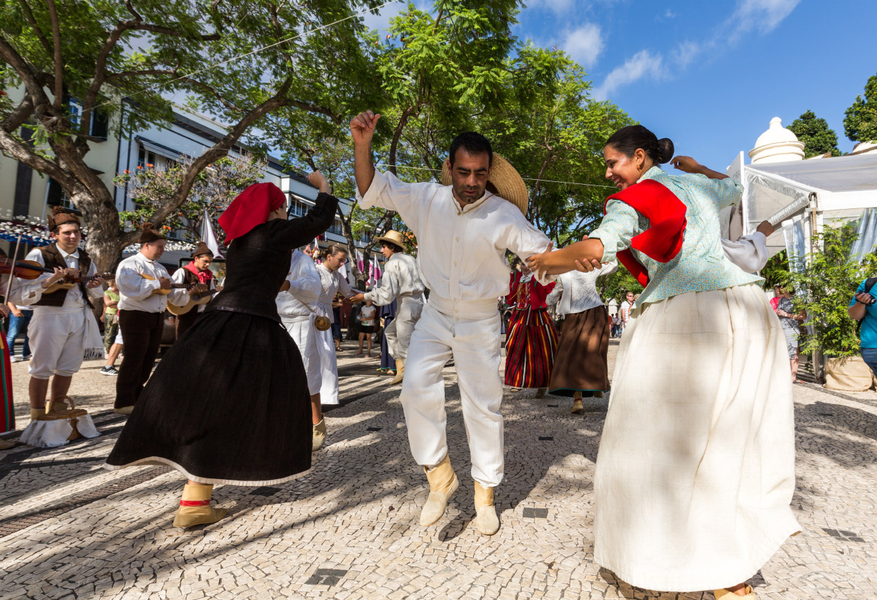 Locals dance in street in Portugal