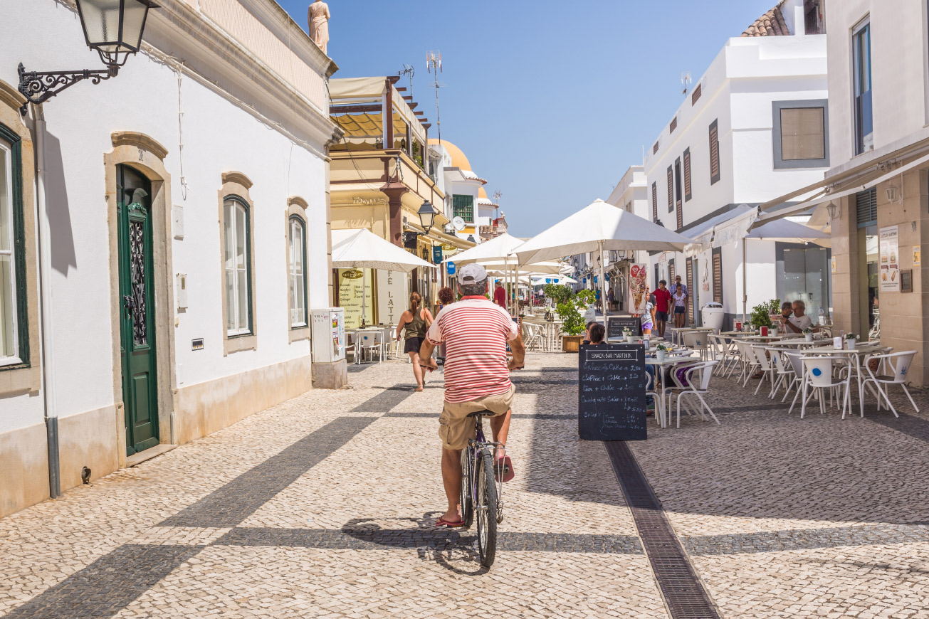 Man cycling on street in Portugal