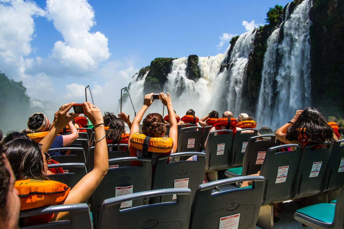 Travellers enjoying the boat tour at the Iguazu Falls