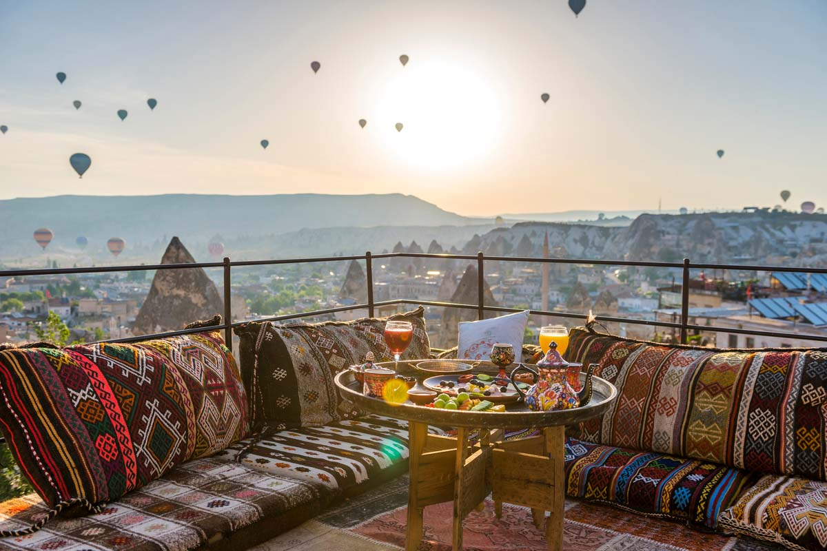 Traditional Turkish breakfast with the view of Cappadocia's hot-air balloons