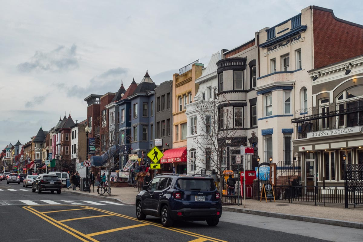 Colorful townhouses on Main street in Adams Morgan district