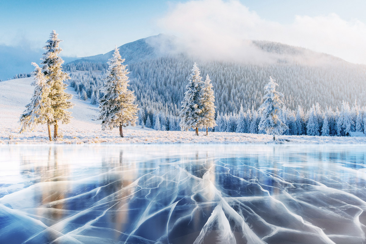 The famous blue ice appears in a frozen lake in the Carpathian Mountains