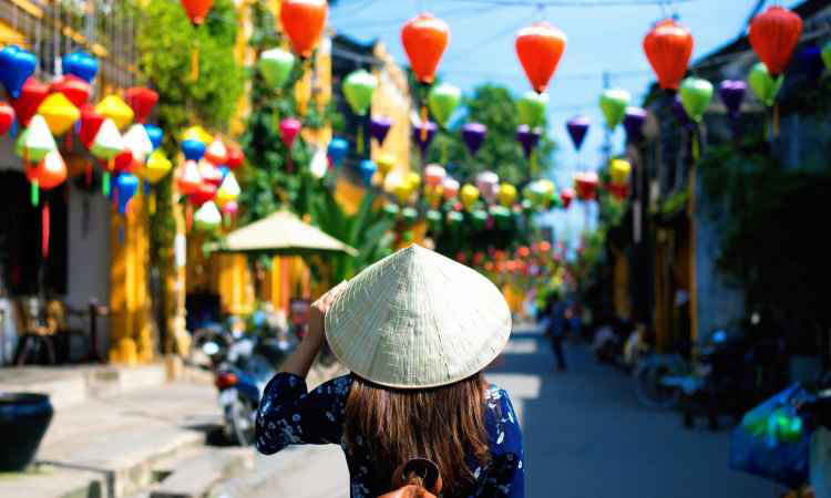 Woman tourist wearing straw hat in Vietnam Black Friday