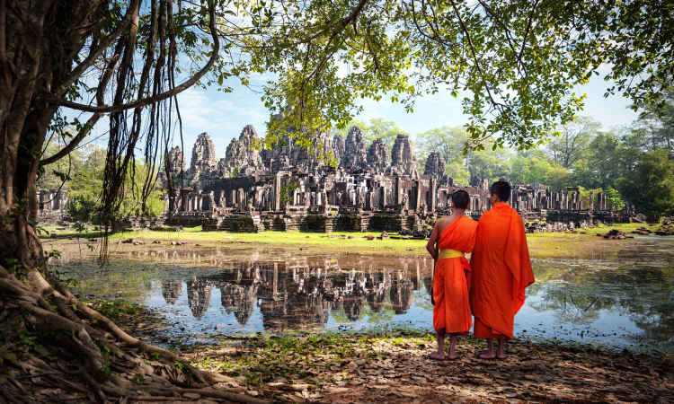 Monks stand in front of Angkor Wat, Cambodia Black Friday