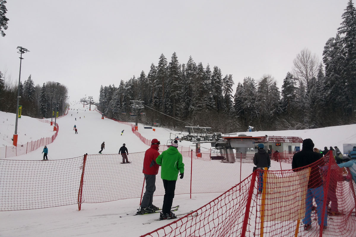 Alpine skiers near the Silichy ski lift in Belarus