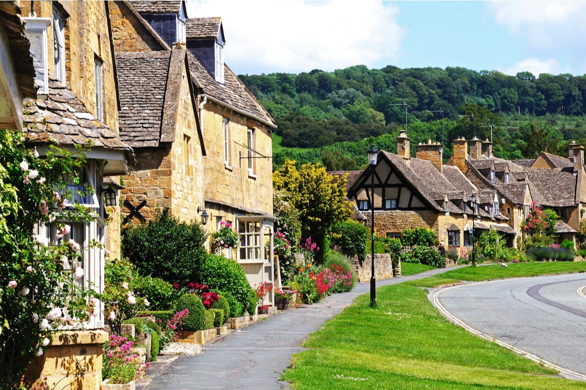 Pretty cottages along High street in Cotswolds