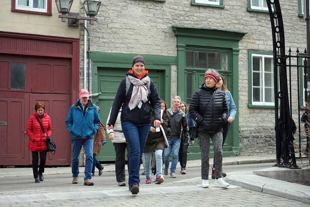 Nomad Quebec Walking Tours owner Marie leads a tour through the historic streets of Old Quebec