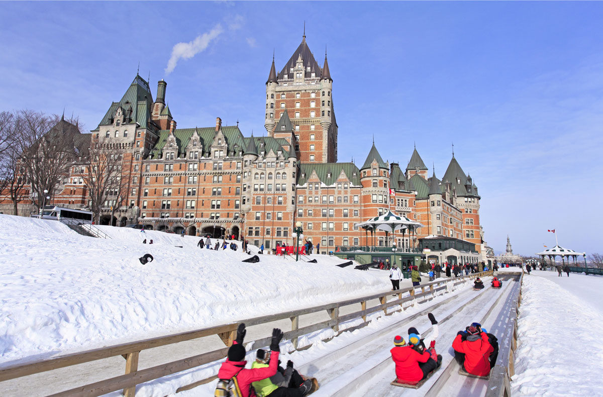 Quebec City in winter with a traditional slide descent.