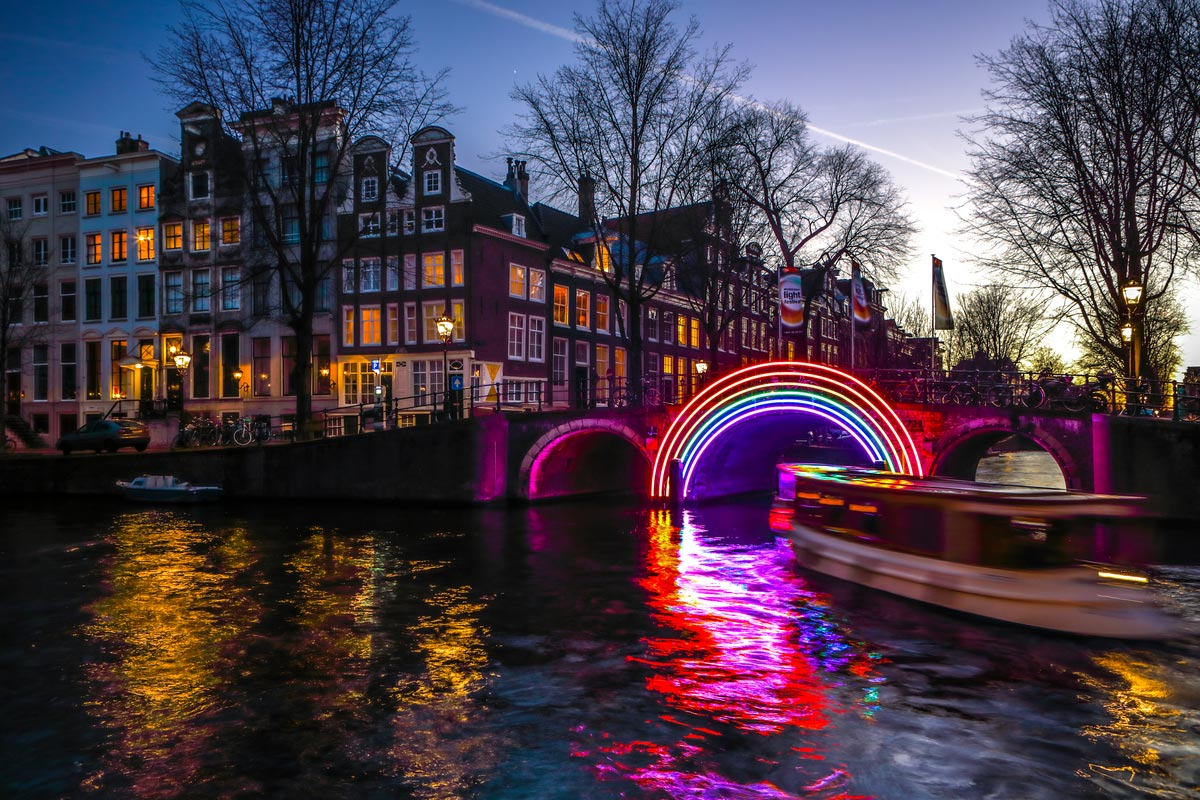 Light installations on night canals of Amsterdam within Light Festival