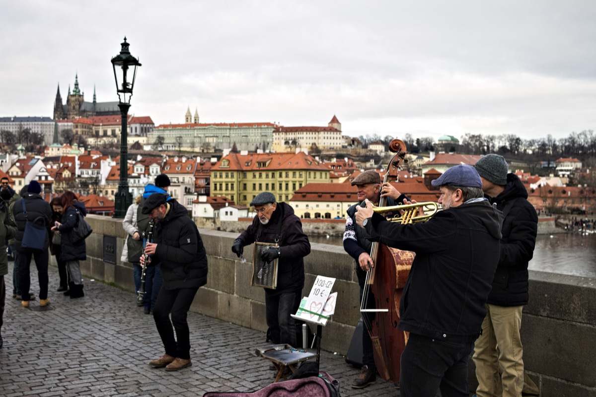 See the street musicians play music on the Charles Bridge