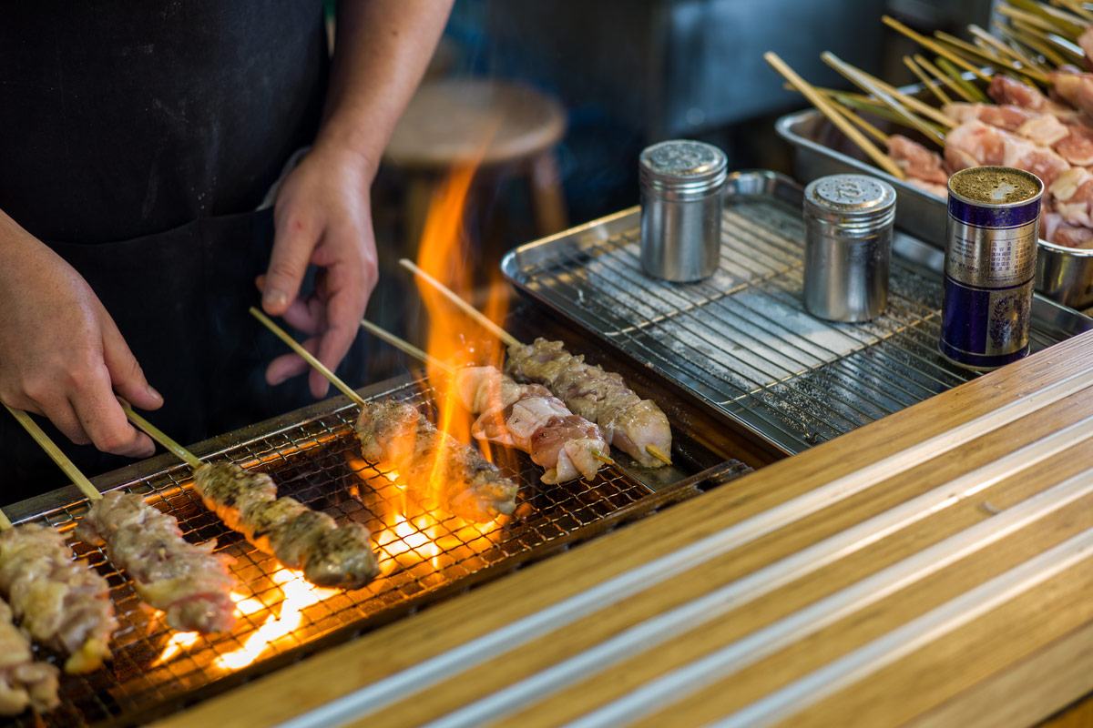 Traditional yakitori chicken stand in Japan at street food vendor market