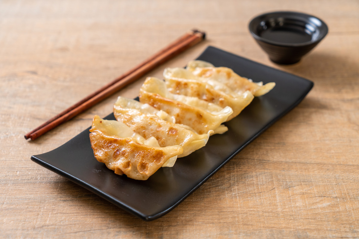 Fried Japanese gyoza dumplings with soy sauce