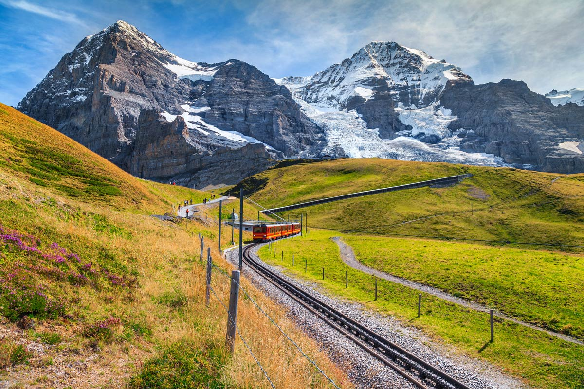 Famous electric red tourist train coming down from the Jungfraujoch station