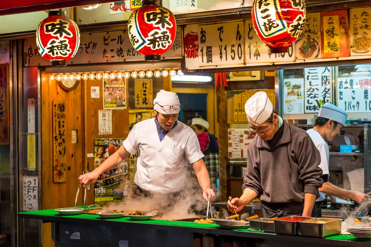 Japanese chefs cooking traditional Japanese street food