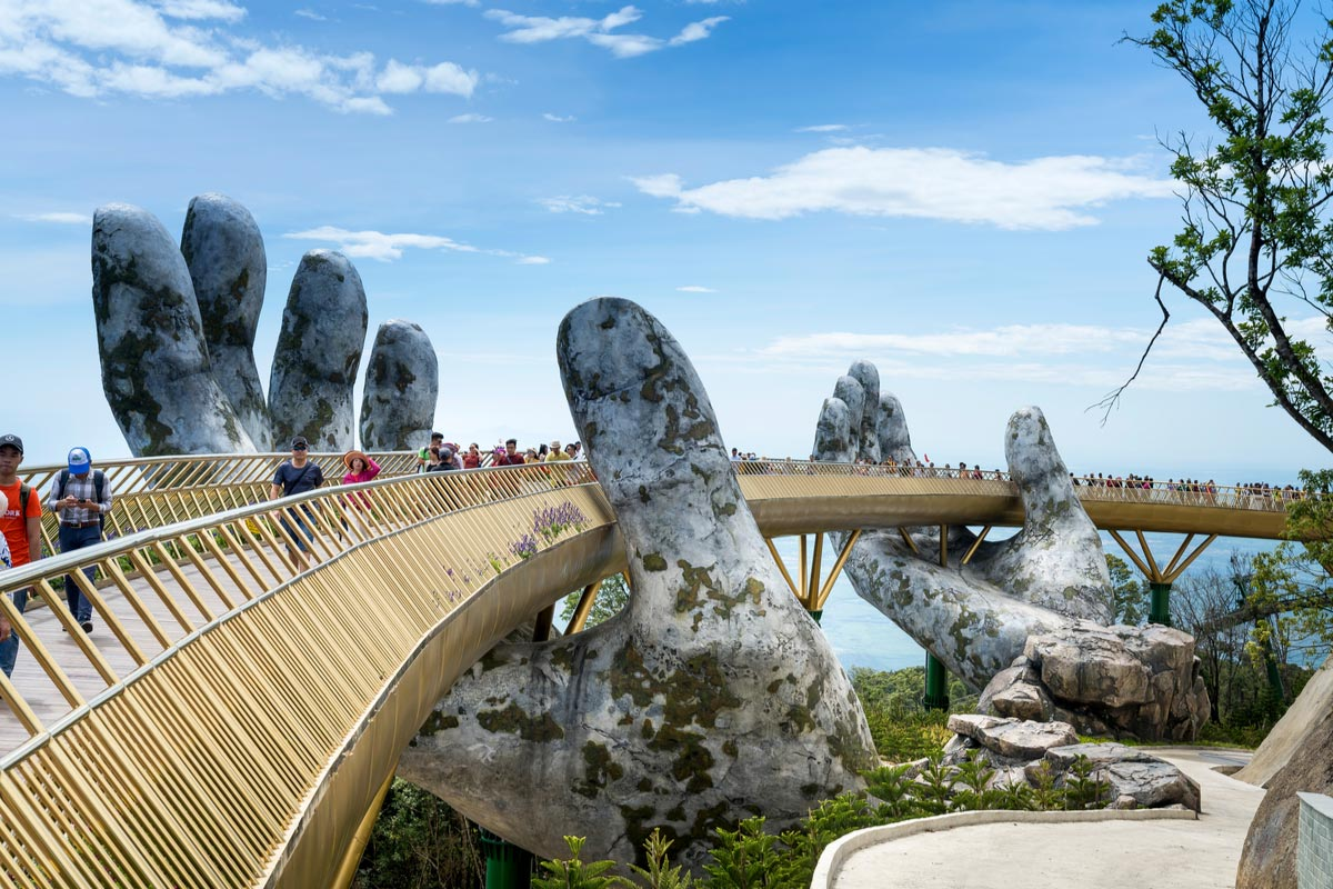 The Golden Bridge is lifted by two giant hands in the tourist resort on Ba Na Hill in Danang, Vietnam