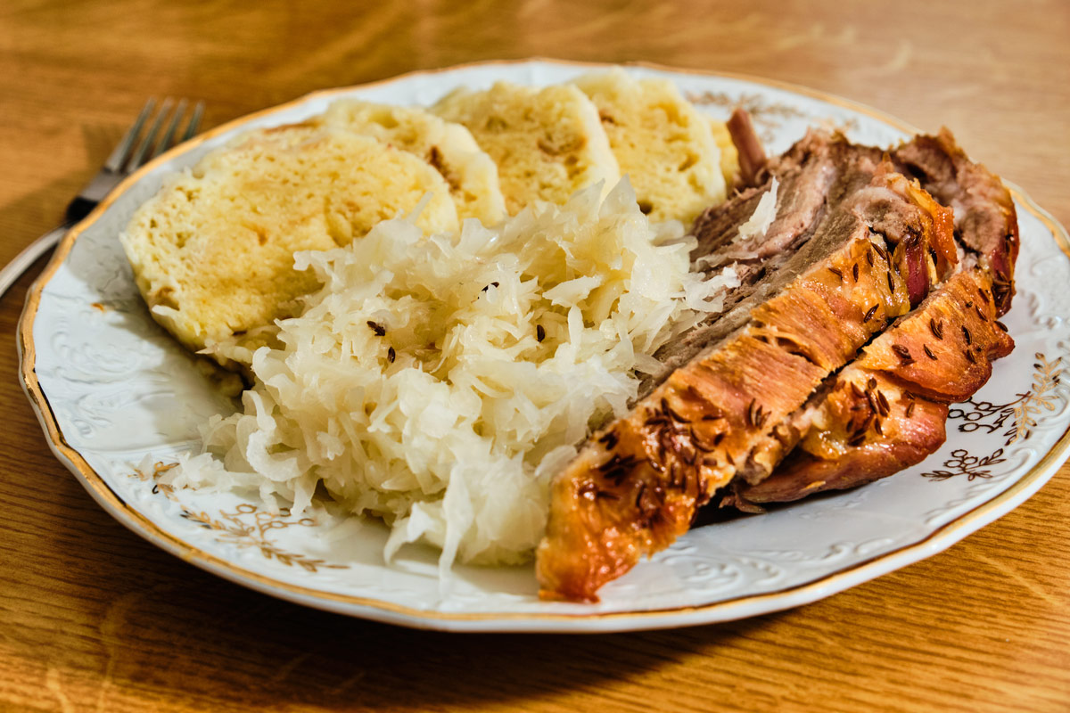 Traditional tasty czech food ,vepro knedlo zelo, pork meat with dumplings and cabbage