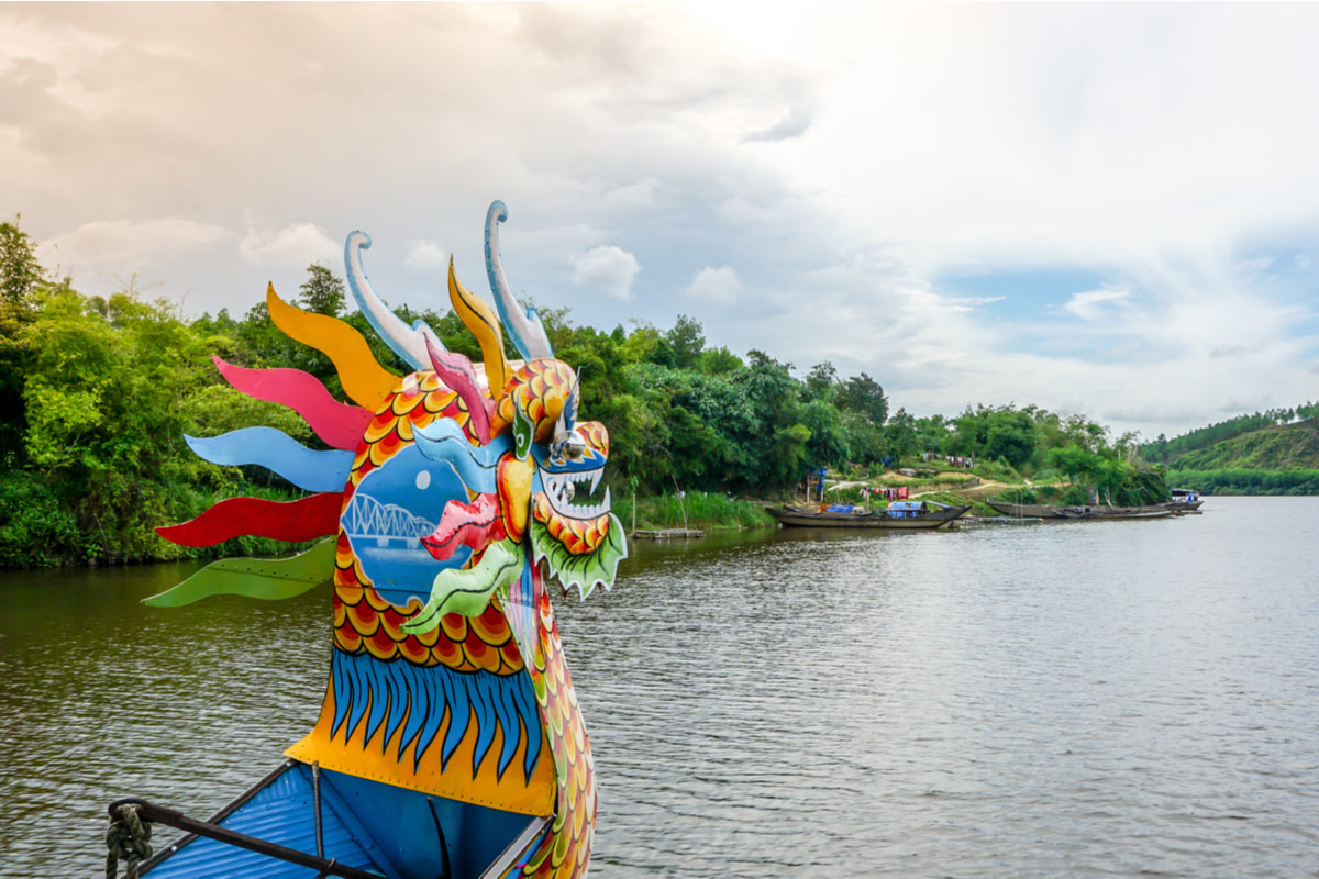 Typical dragon boat on the Perfume River in Hue, Vietnam