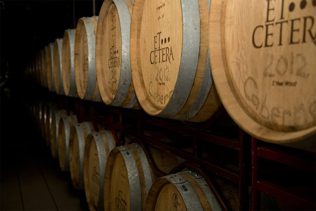 White wine fermenting in oak barrels at Et Cetera Winery