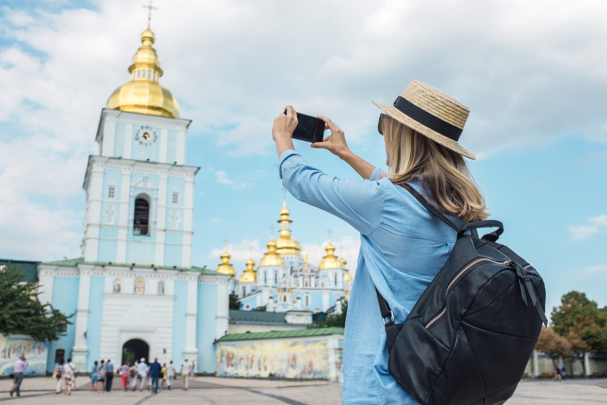 Women taking photo of gold dome building in Kiev reasons to visit Kiev