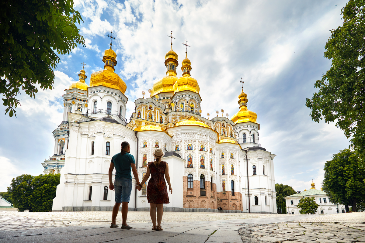 Couple standing in front of St Sophia Cathedral reasons to visit Kiev
