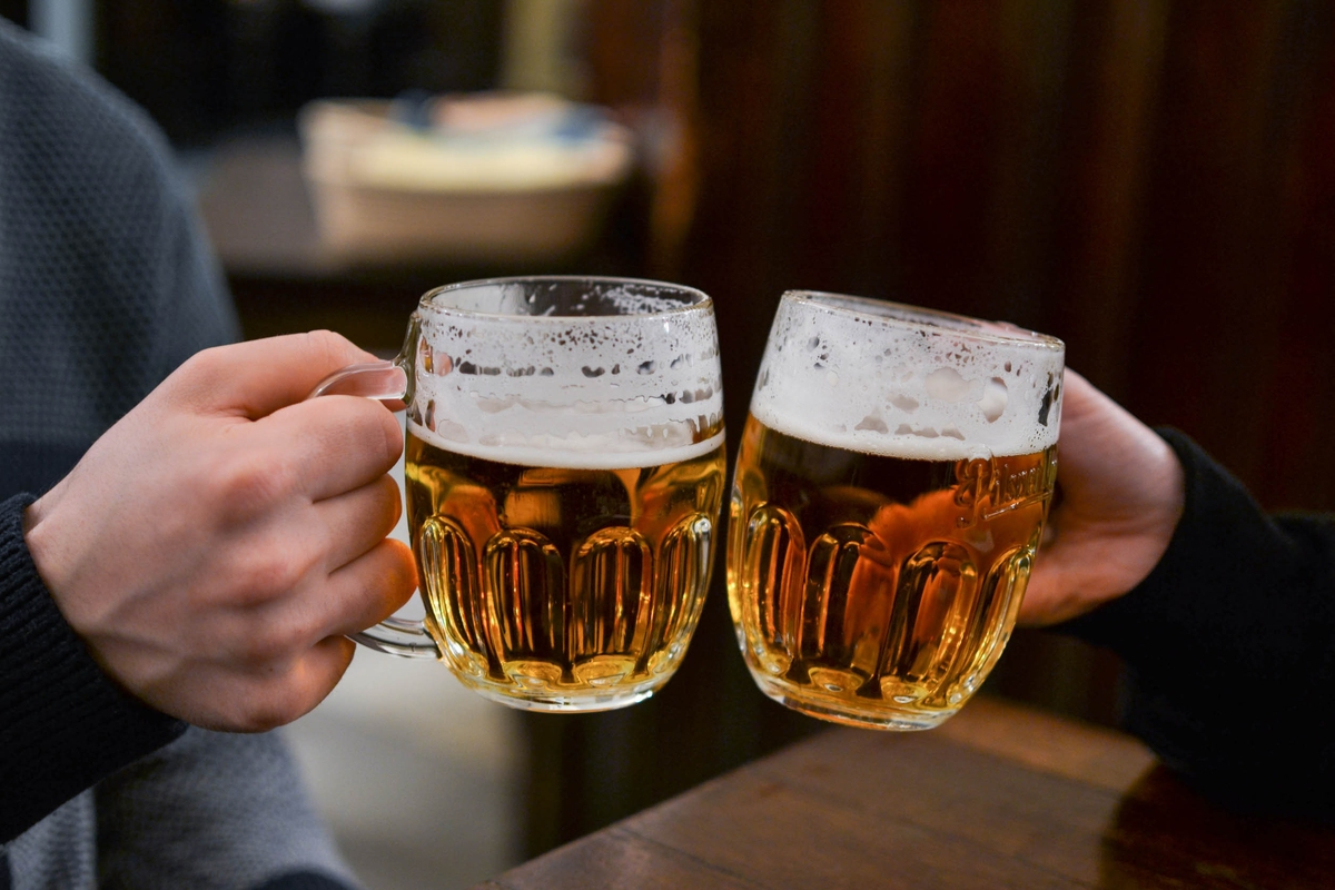 Men cheers with beer May Travel