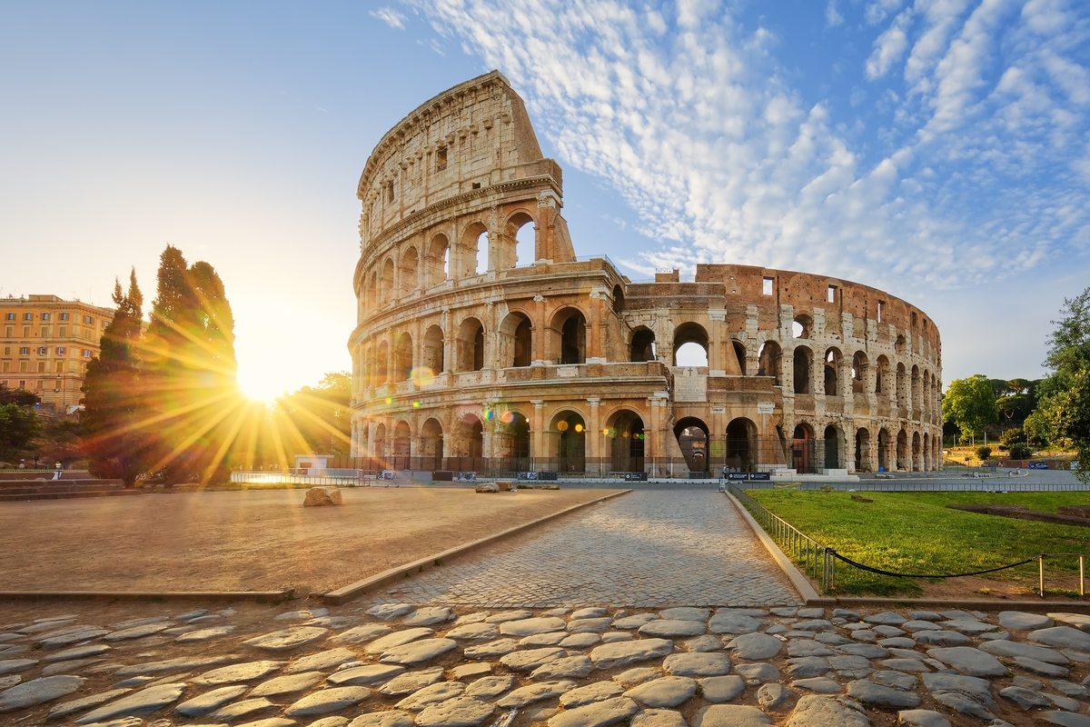 Sun shining on Colosseum in Rome Europe