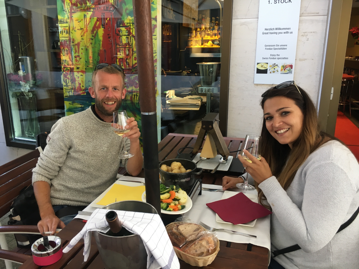 Engaged couple enjoy dinner and wine travel friendships