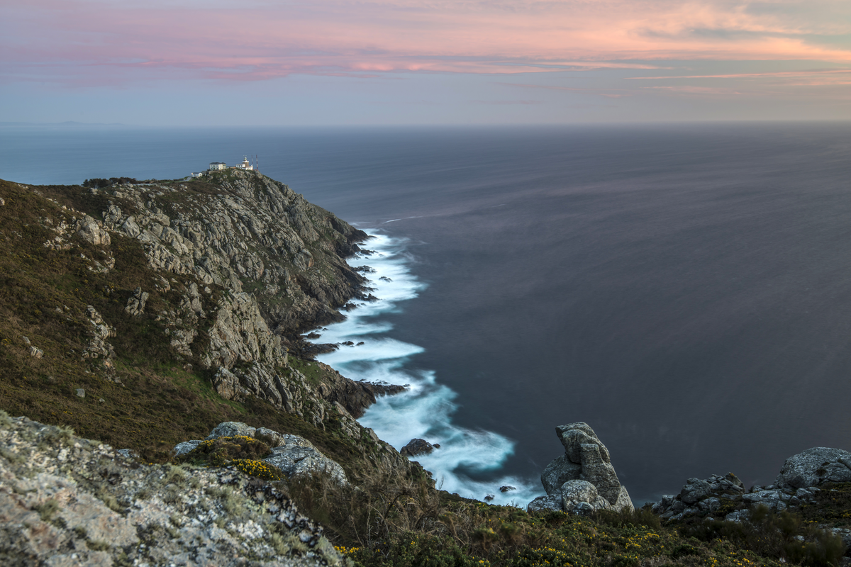 View of lighthouse and cliffs at Cape Finisterre in Spain