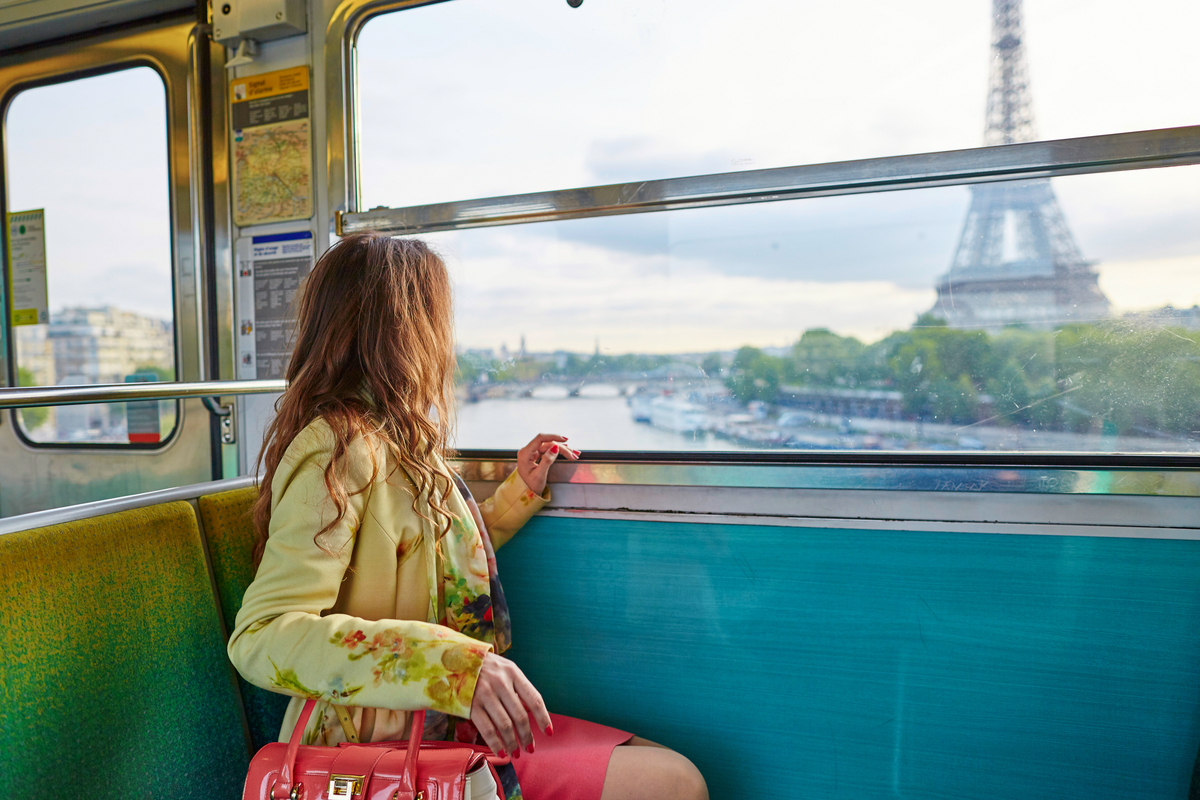 Girl admires view from train in Paris rail tour benefits