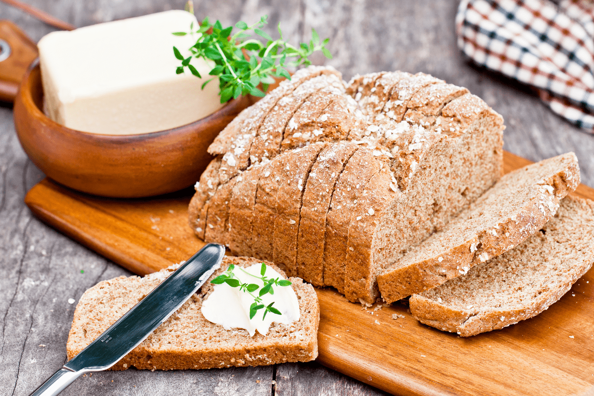 Loaf of Irish soda bread with butter St. Patrick's Day