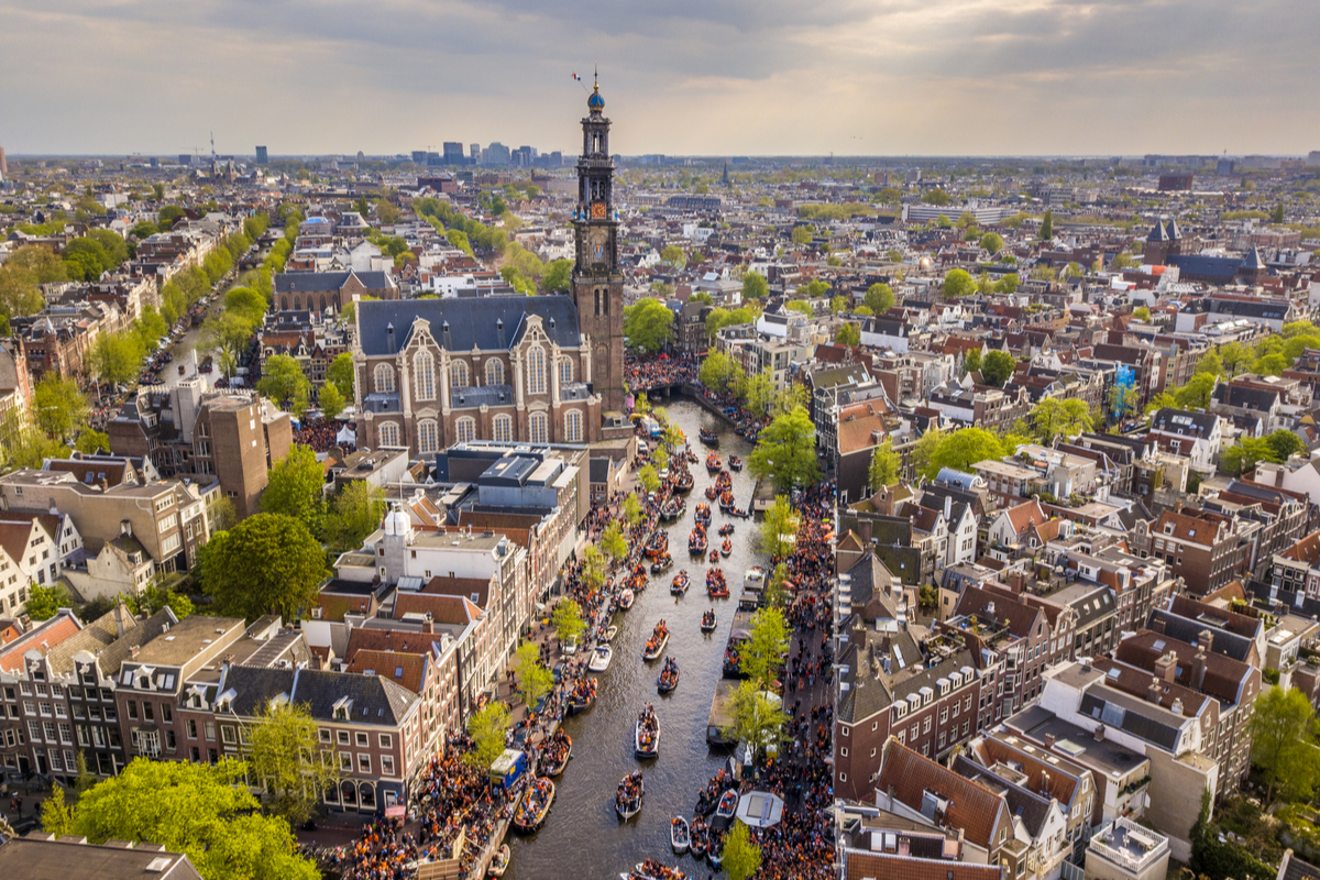View of WestKerk and canals in Amsterdam on King's Day