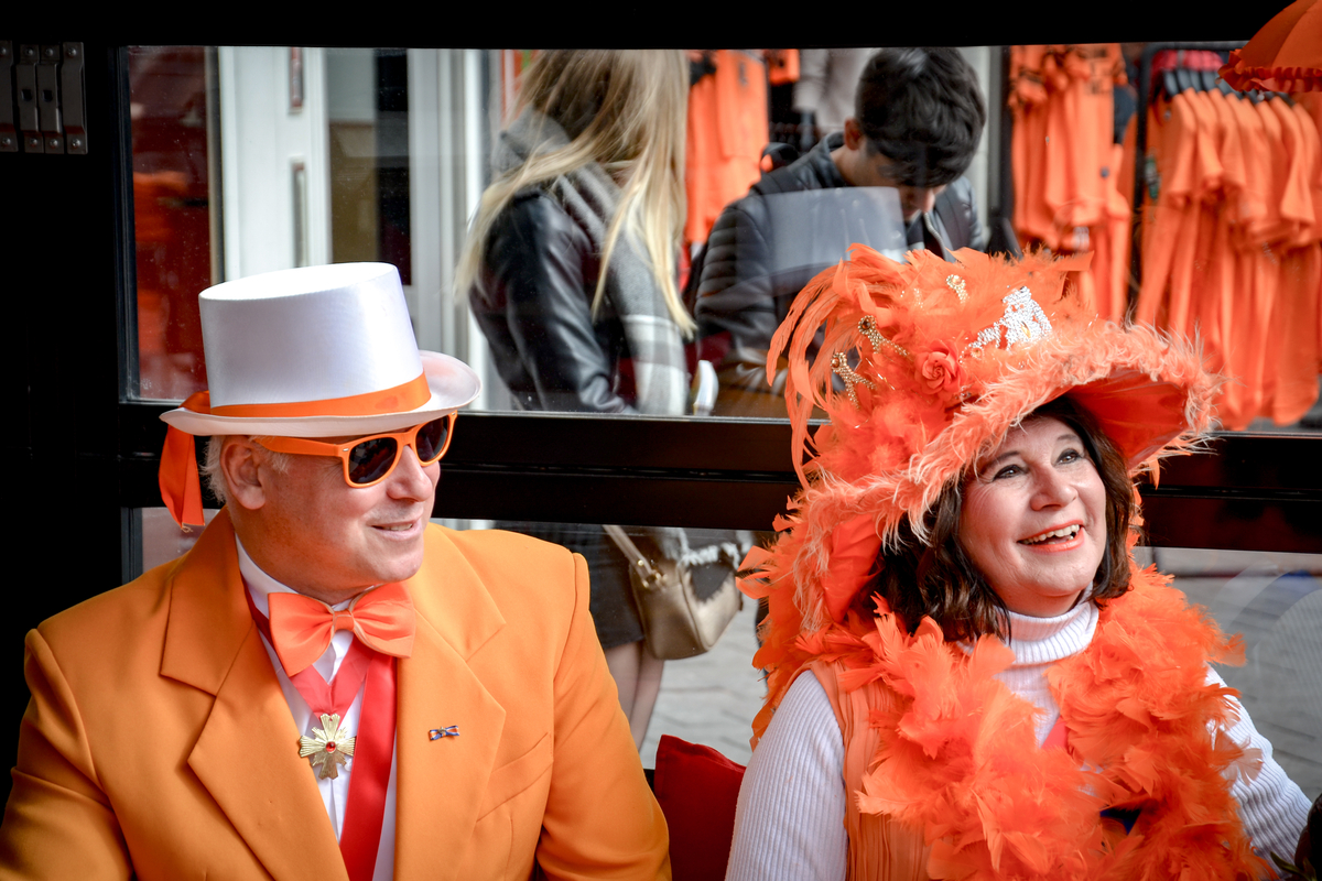 Couple dressed in orange King's Day