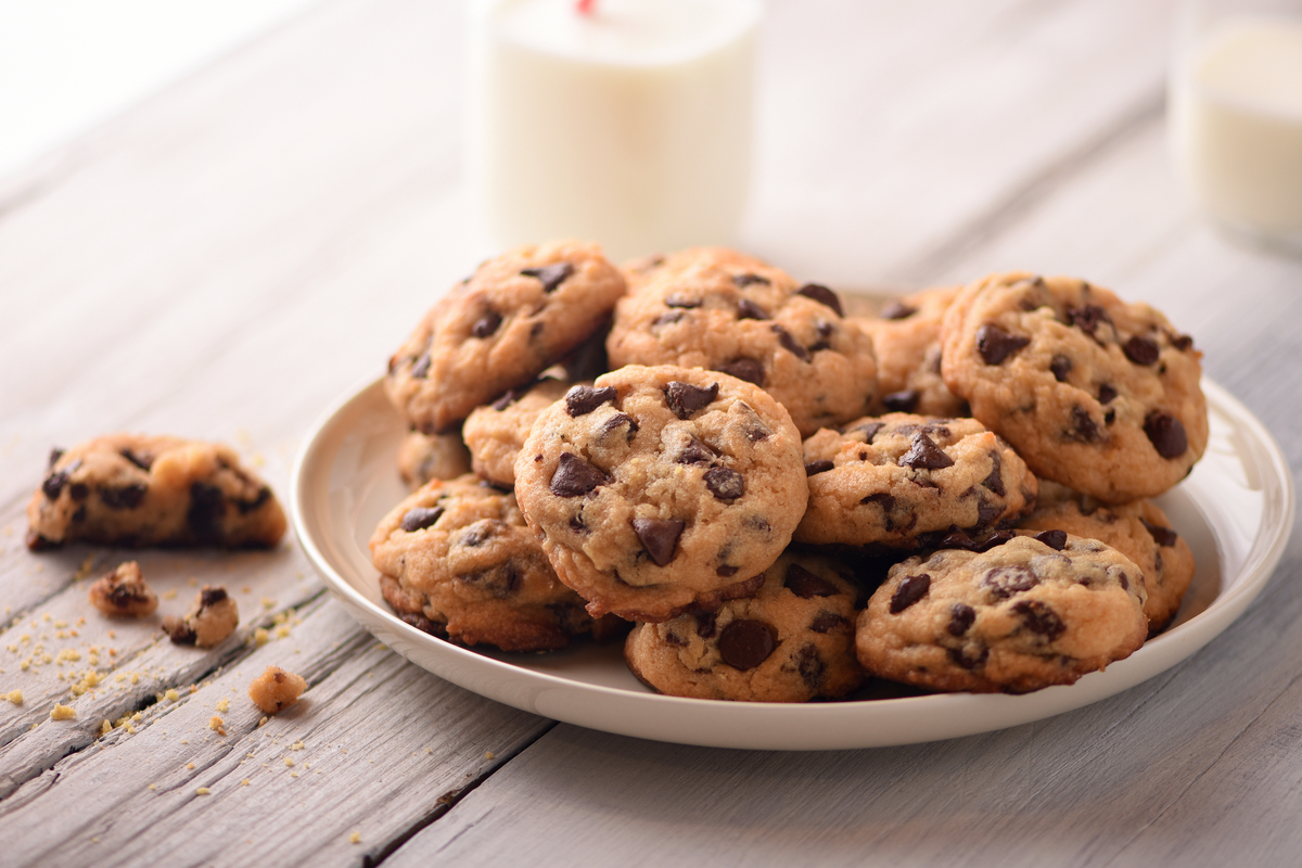 Plate of cookies with milk world food & drinks