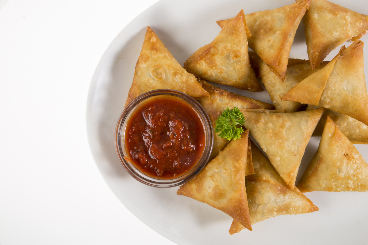 Plate of samosas with dipping sauce world food & drinks