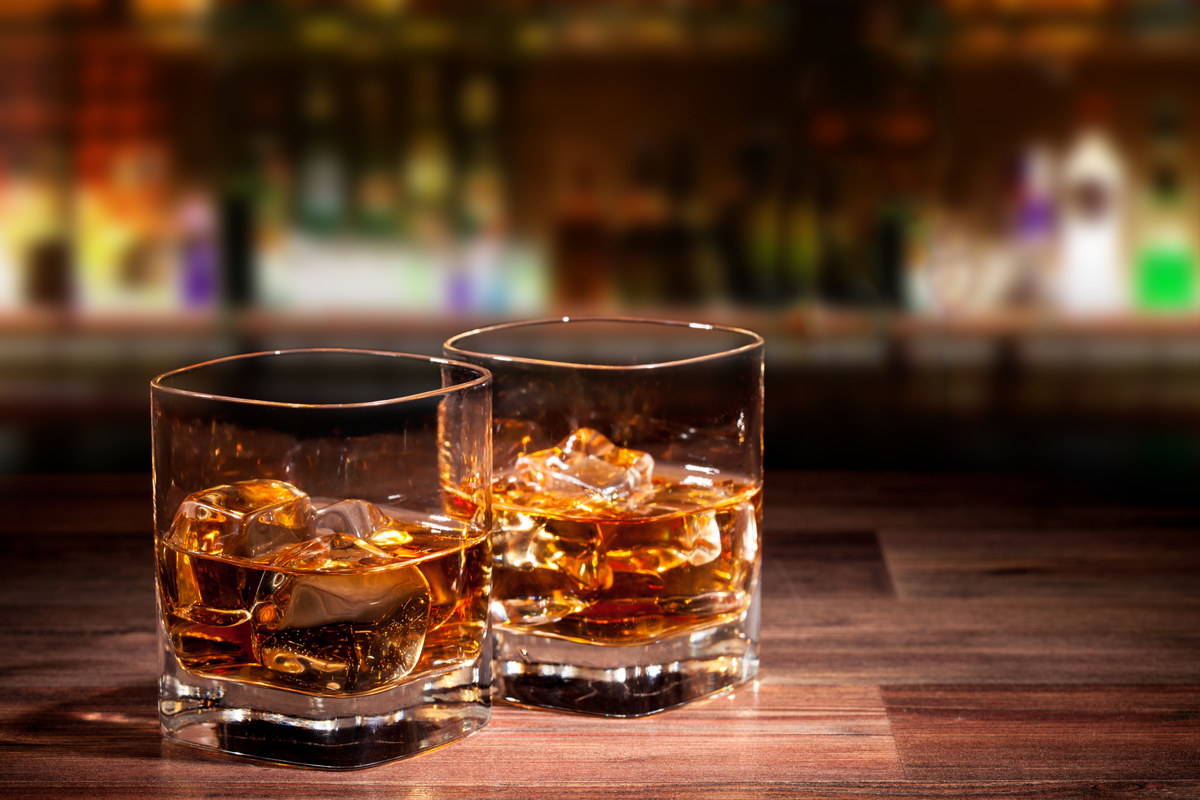 Two glasses of whiskey on table world food & drinks