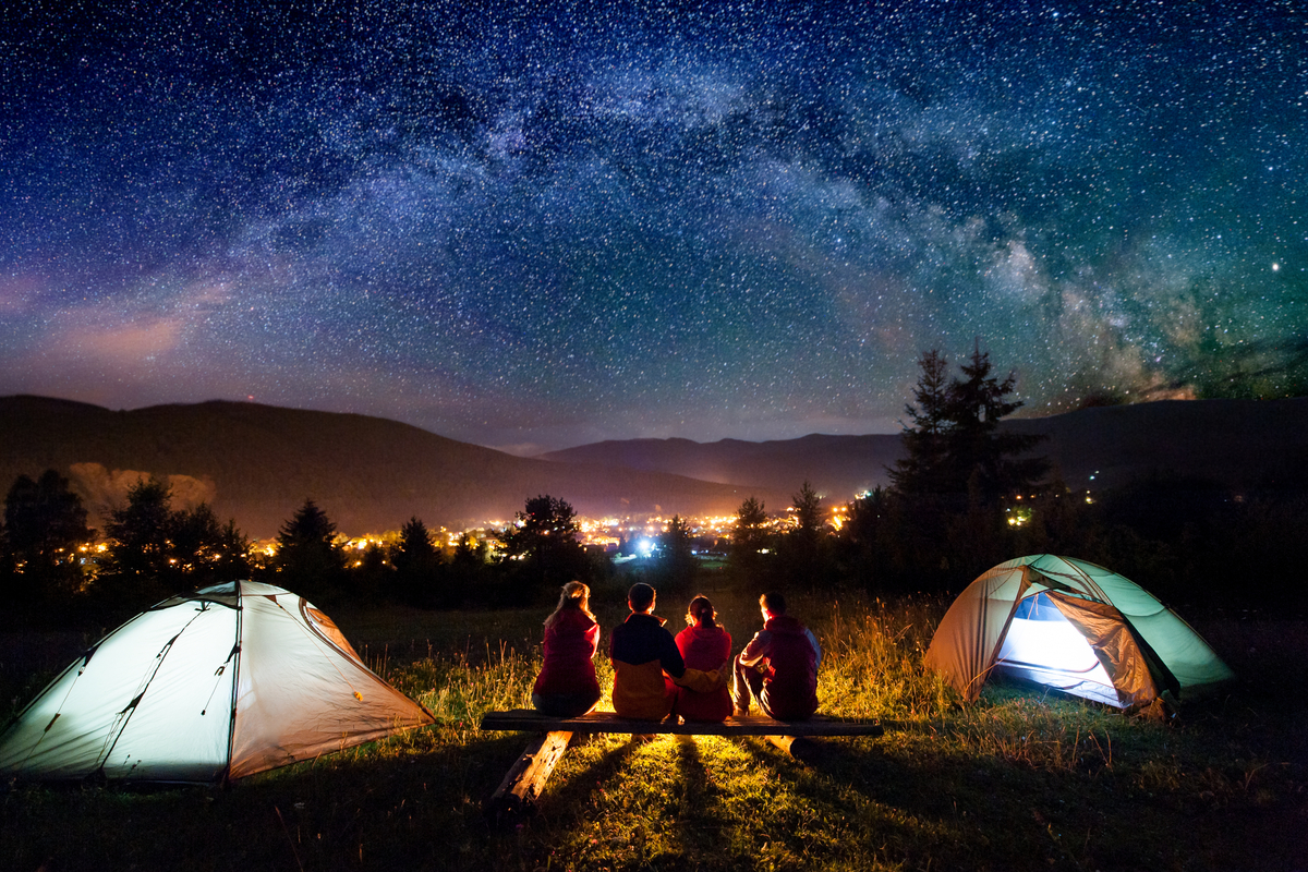 Family camping and stargazing