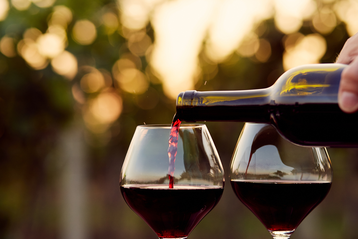 Pouring red wine two glasses