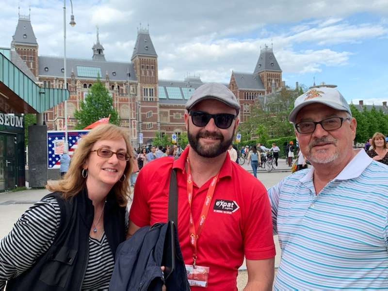 Travellers with tour guide in Amsterdam family travel