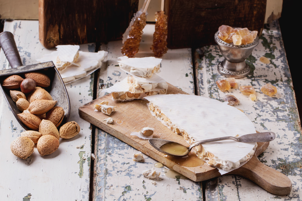 Table with Spanish turron and almonds World Baking Day