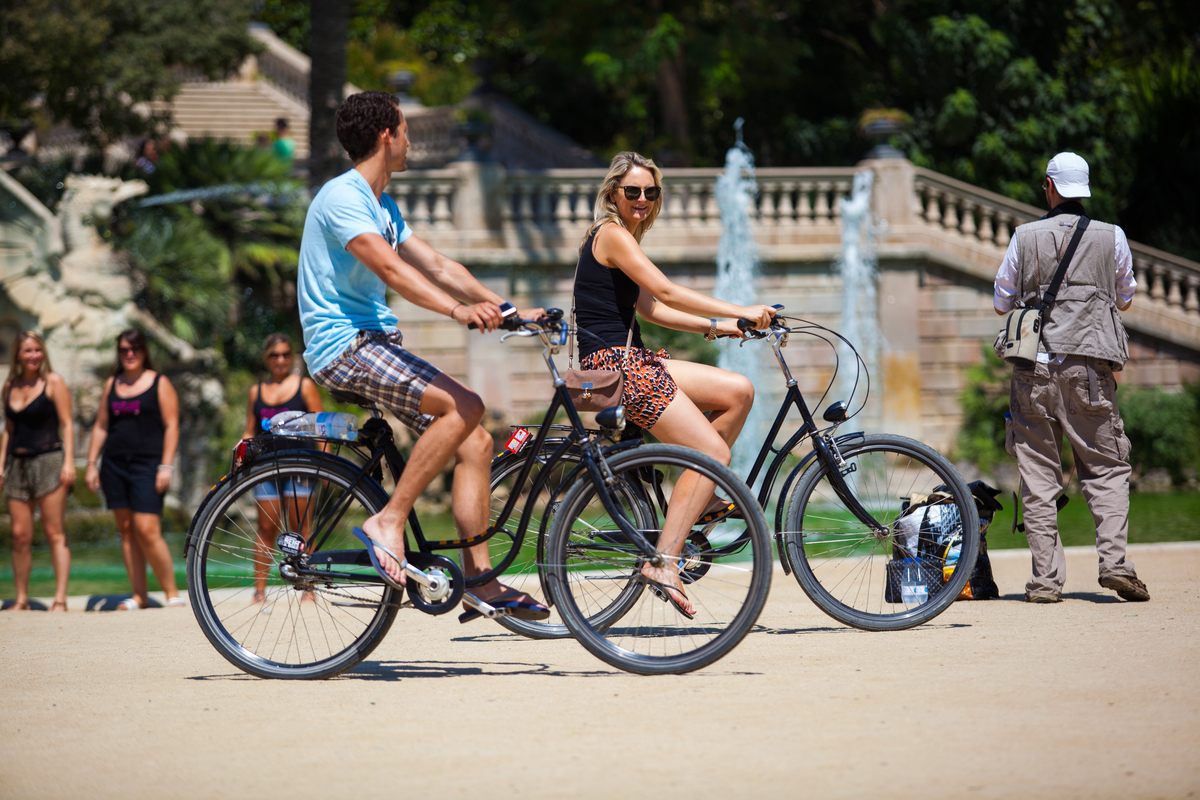 Couple ride bicycles in Barcelona
