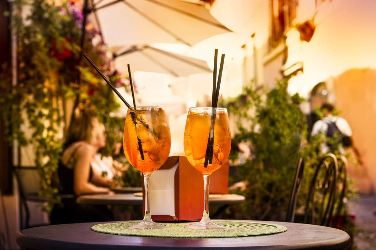Two glasses of Aperol spritz at cafe cocktails