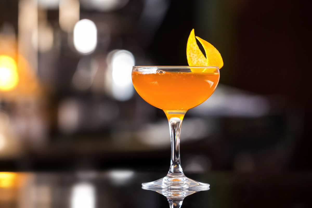 Sidecar  with orange peel on bar counter cocktails
